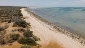 Shoreline and beach shot. A wide shot of the shoreline and beach. Camera moves to the left stock footage