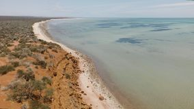 Shoreline and beach shot. A wide shot of the shoreline and beach. Camera moves to the left stock video footage