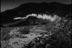 Wide shot of smoke emitting from gold mining plant stock footage