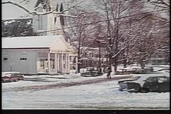 Wide shot of snowy day in small town stock footage