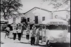 Wide shot of students boarding school bus