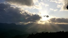 Wide shot of the sun ray breaking through cloud from the top of mountain moiwa, hokkaido, japan stock video footage
