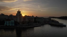 Wide Shot of Sunset Over Havana Port in Cuba. 8773 A wide establishing shot of the sun setting over Havana, Cuba stock footage