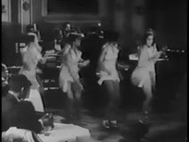 Wide shot of tap dancers performing in nightclub, 1930s