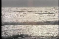 Wide shot of tranquil ocean shore stock video
