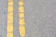 Old Yellow Lines On an Old Asphalt Road stock image