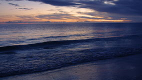 A wide shot of the waves and the horizon on dawn. Wide shot of the sky on dawn stock video