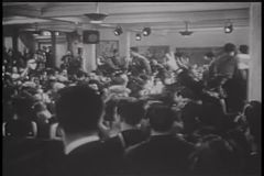 Wide shot of World War II servicemen celebrating stock footage