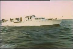 Wide shot yacht in ocean stock footage