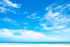 Wide sky with clouds over turquoise sea, Fiji. Sandy beach, colorful Pacific Ocean and wide blue sky with white clouds. Deep horizon Royalty Free Stock Images