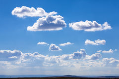 Wide sky. Wide, cloudy blue sky on hills Royalty Free Stock Image