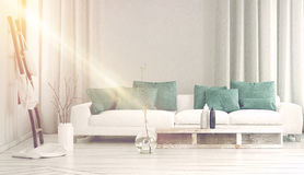 Wide sofa in front bathed in yellow sunlight Stock Photo
