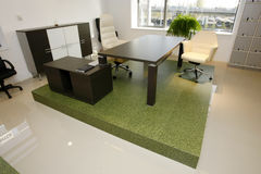 Wide spacious office interior. Wide angle interior of office with desk and chairs on green floor stock photography