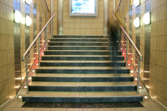 Wide staircase with moving person Royalty Free Stock Image
