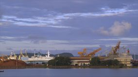 Bauxite alumina Terminal, Kaloum, Conakry, Guinea. Wide still shot from ocean, Bauxite alumina area, Conakry, serene grey water, bright sky with dark, white stock video