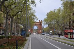 Street with Historic Arc in Barcelona. Wide street with Historic Arc in Barcelona Stock Images