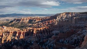 Wide Sunset over Bryce Canyon National Park, Utah. Timelapse panning sunset over Bryce Canyon National park, Utah. The sun illuminates the orange hoodoos under a stock footage