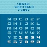 Wide techno poster font. Geometric angular characters. Wide techno poster font. Geometric angular letters with numbers Royalty Free Stock Images