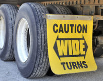 Wide turns sign and tires on semi-trailer Stock Photography