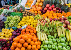 A wide variety of fruits in trays on the market Royalty Free Stock Photography