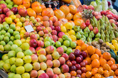 A wide variety of fruits in trays on the market stock photos