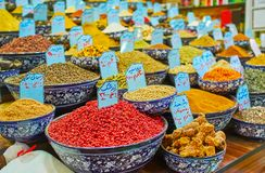 The wide variety of spices, Vakil Bazaar, Shiraz, Iran. The wide variety of spices, herbs, dried barries and roots in bowls with their names and prices, wrote in stock photos