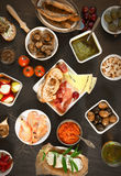 Wide Variety Tapas on Brown Table Stock Photos