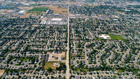 Wide view from above of subdivisions and streets with trees stock video