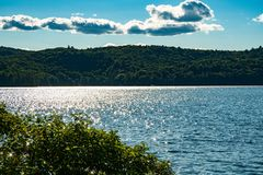 A summers evening lake side. Wide view of beautiful fresh water lake in cottage country Stock Image