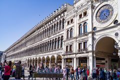 Wide view of the Biblioteca Nazionale Marciana in Venice. The Biblioteca Nazionale Marciana Library of St. Mark, and the astrological clock on the Piazza San Royalty Free Stock Photos