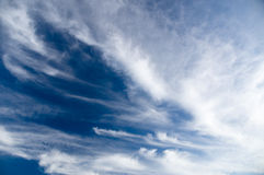 Wide view of blue sky with spreading cirrus clouds Royalty Free Stock Images