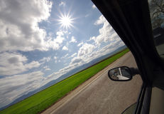 Driving in sunny day Stock Photography