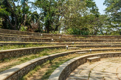 Wide view of circular concrete steps in a green garden, Chennai, India, April 01 2017 Royalty Free Stock Photo