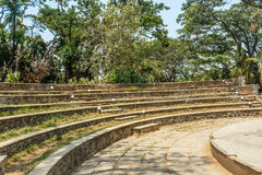Wide view of circular concrete steps in a green garden, Chennai, India, April 01 2017 Royalty Free Stock Photography