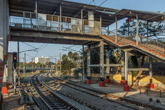 Wide view of curve train tracks and foot over bridge, Chennai, Tamil nadu, India, Mar 29 2017 Royalty Free Stock Image