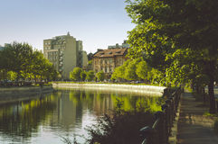 Wide view of Dambovita river and old houses in Izvor area, near the Parliament building Stock Photo