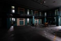 Derelict Prison Cells - Restricted Housing Unit - Abandoned Cresson Prison / Sanatorium - Pennsylvania. A wide view of derelict prison cells in the Restricted royalty free stock photography