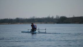 Wide view of Disabled sportsman rowing on the river in a canoe. Rowing, canoeing, paddling. Training. Kayaking. Wide view Disabled sportsman rowing on the river stock video