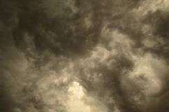 Ominous storm clouds. Wide view of dramatic summer dark storm clouds. Great atmospheric mood royalty free stock photography