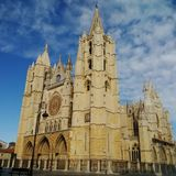 Cathedral of the city of León in Spain. A wide view of the façade of this ancient church with blue sky in background royalty free stock photography