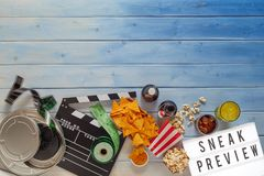 Wide view of film container and food and drinks Stock Photography