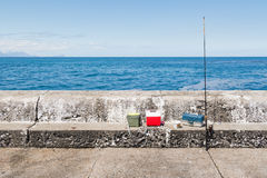 Wide view of fishing equipment on harbor wall Royalty Free Stock Photo