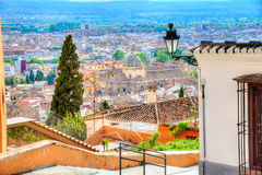 Wide view of a garden inside Alhambra Palace, Spain. Wide view of a garden and beautiful tower architecture inside Alhambra Palace, Spain Stock Photography