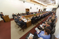 Wide view on the hall and speaker on Round table Elections Royalty Free Stock Photos