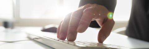 Businessman using white computer keyboard royalty free stock photo