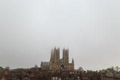 Wide view of Lincoln Cathedral, in the fog. Stock Photo