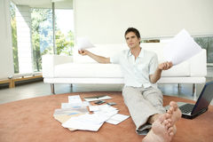 Wide View of Man with Paperwork Sitting on Floor Royalty Free Stock Photography