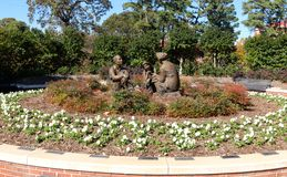 Wide view of men and women statues in a garden on the campus of Ole Miss Stock Photography