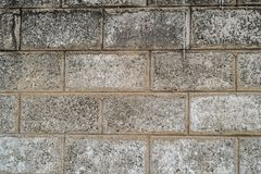 Wide view at modern wall made ouf of concrete blocks stock photography
