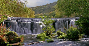 Wide View of Monsal Weir Waterfall, Monsaldale Stock Photography